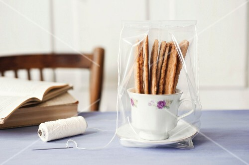 Almond biscuits in a cup as a gift