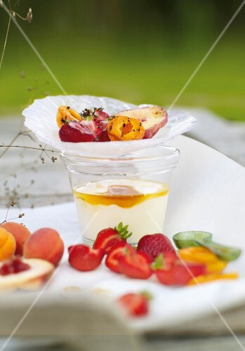 Grilled fruits on yogurt glass