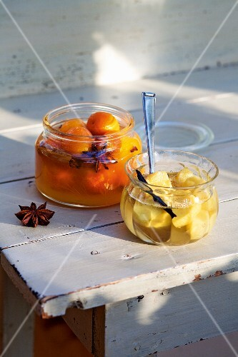 Homemade preserved kumquats and ginger roots in syrup