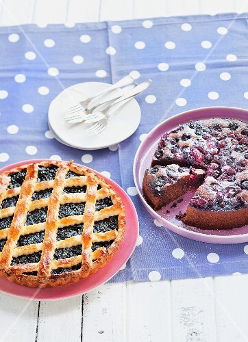 Blackberry tart and a chocolate cake with berries