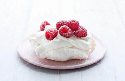 A meringue tartlet with raspberries