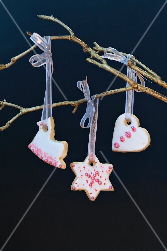 Iced biscuits hanging on a tree