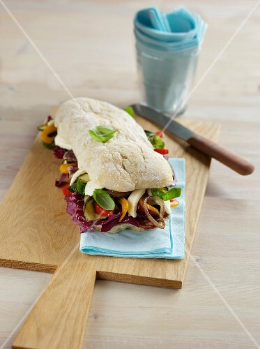Ciabatta with salami and summer vegetables