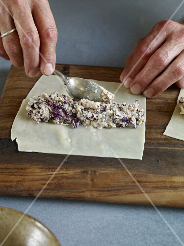 Cannelloni being filled with ricotta and radicchio