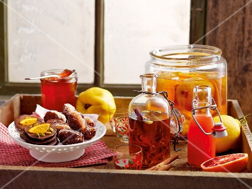 Winter cuisine: quince jelly, dates, chocolate biscuits and various different liqueurs