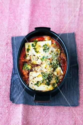 Tofu with herbs and lemon zest in tomato sauce