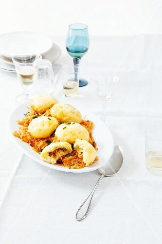 Yeast dumplings on a bed of pepper and sauerkraut