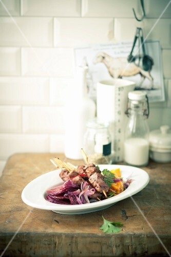 Lamb skewers on beetroot and mango carpaccio