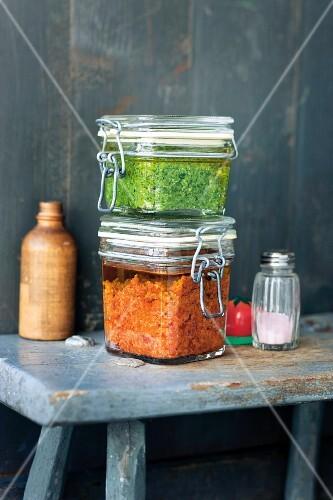 Parsley pesto and tomato pesto in flip-top jars