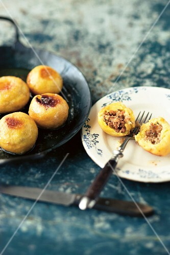Fried potato balls filled with minced wild boar