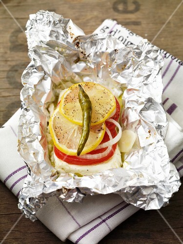Feta parcel with tomatoes in tin foil