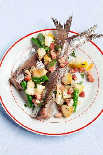 Soused herring with pears, beans and bacon
