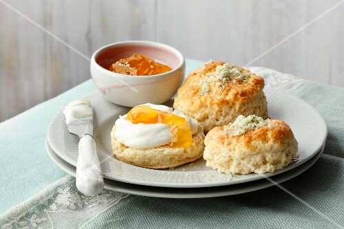 Rosemary scones with clotted cream and apricot jam