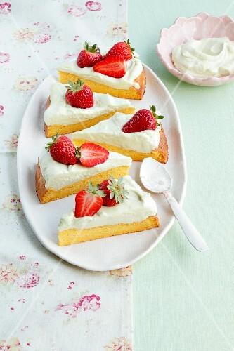 Pumpkin sponge cake with strawberries and avocado cream