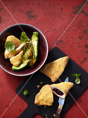 Fried chicken stuffed with polenta and olives served with grilled courgettes