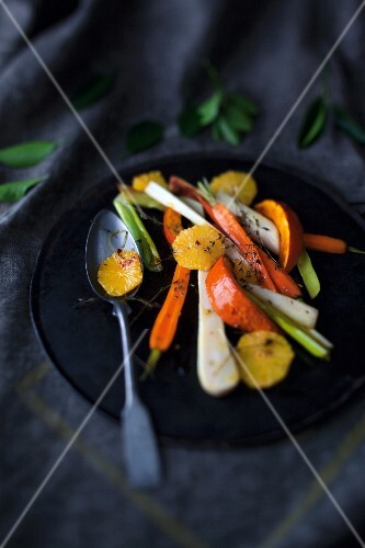 Oven-roasted vegetables with orange and thyme on a plate