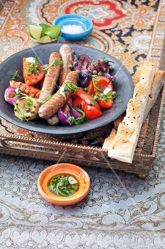 Merguez sausage with a gilled vegetable salad