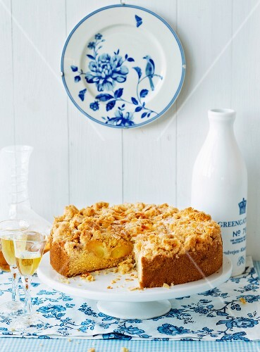 Apple crumble cake served with apple brandy