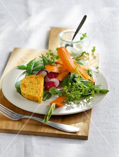 Carrot terrine with a mange tout and spinach salad