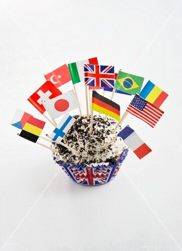A cupcake decorated with various flags