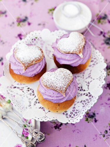 Profiteroles with blueberry cream and icing sugar