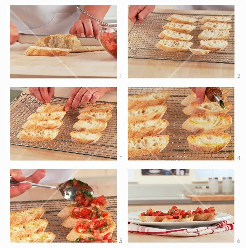 Bruschetta being prepared: bread slices being topped with tomatoes