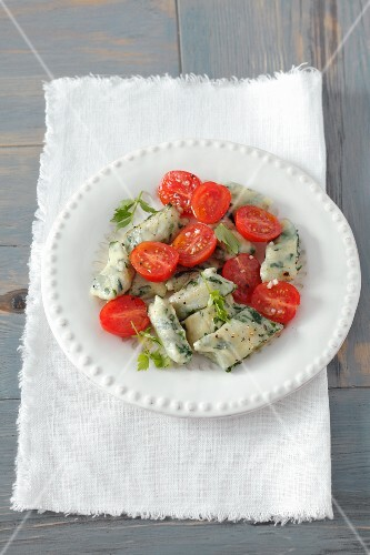 Potato and spinach dumplings with cherry tomatoes