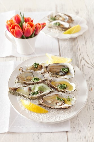 Oysters with parsley butter in salt