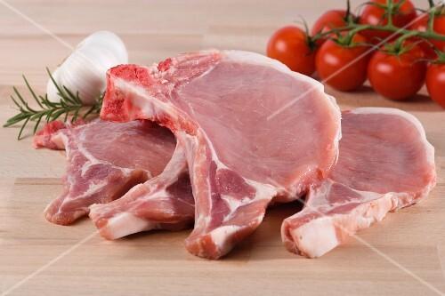 Fresh pork chops, cherry tomatoes, garlic and rosemary