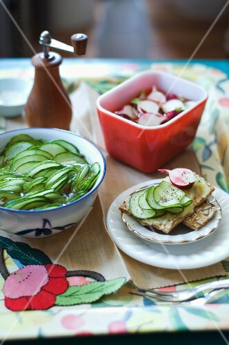 Thinly Sliced Pickled Cucumbers and Pickles Radishes; Both Pickles on Buttered Crackers