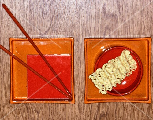 An oriental place setting with noodles