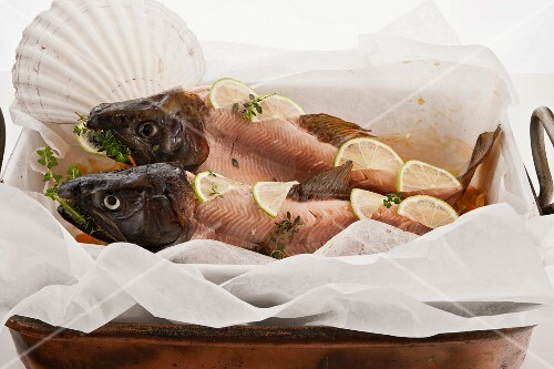 Two skinned Japanese cherry salmon with heads on a bed of vegetables