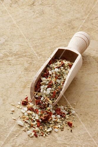 Mediterranean spiced mixture in a wooden scoop