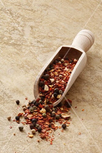 Mexican spice mixture in a wooden scoop