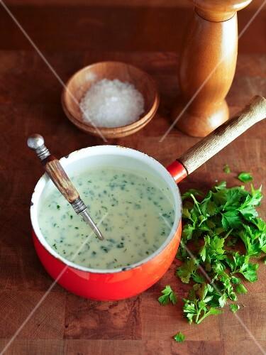 Parsley sauce in a saucepan