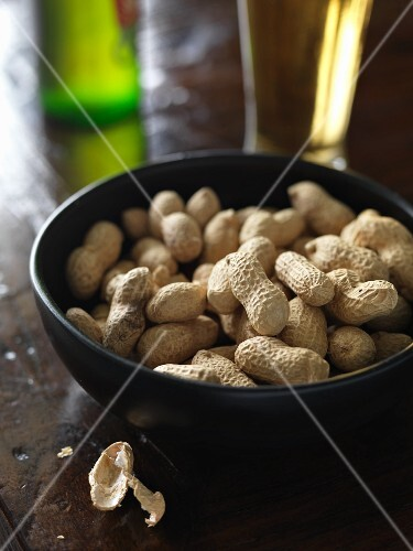 Peanuts in a bowl with a beer