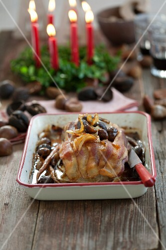 Roast pork in bacon with chestnuts