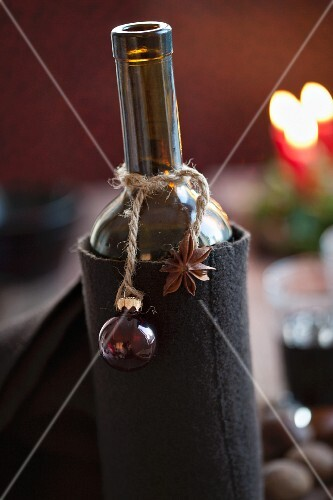 Mulled wine in a bottle with Christmas decoration