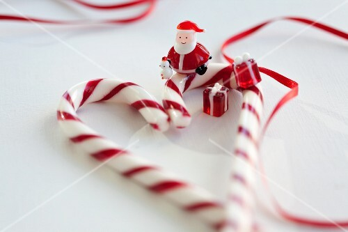 A candy cane heart, a Father Christmas figure and glass ornaments
