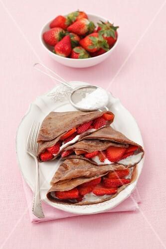 Chocolate pancakes with vanilla quark and strawberries
