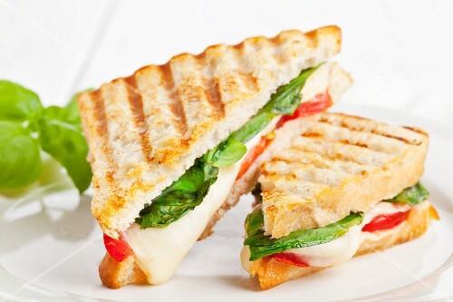 Ciabatta toasties with tomatoes, mozzarella and basil