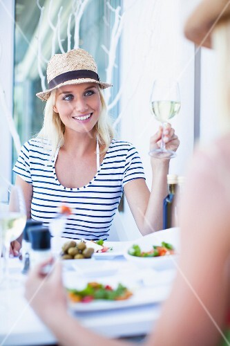 Smiling woman eating in cafe