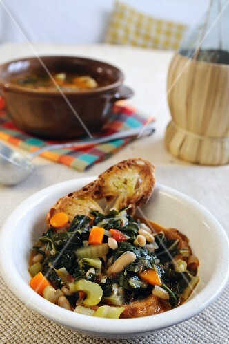 Black cabbage, bean and crostini stew (Tuscany, Italy)
