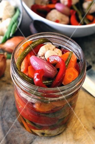 A jar of preserved vegetables