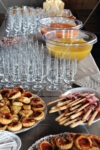 Mini pizzas, grissini and punch on a buffet table (Italy)