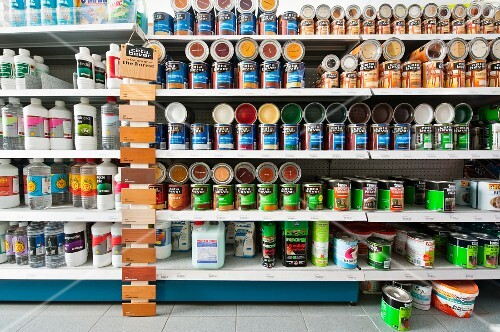 Regale Baumarkt a shelf of paint tins in a diy store buy images stockfood