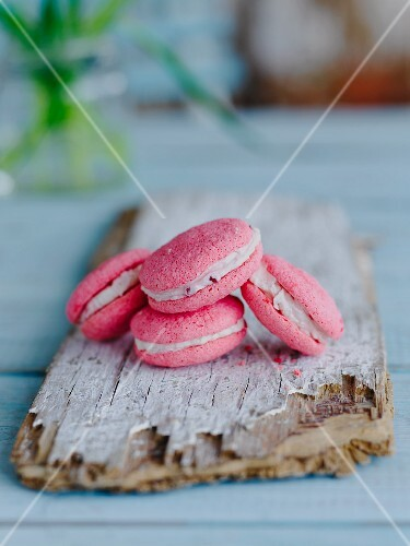 Pink macaroons on a wooden board