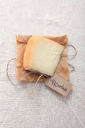 A slice of pecorino with a label