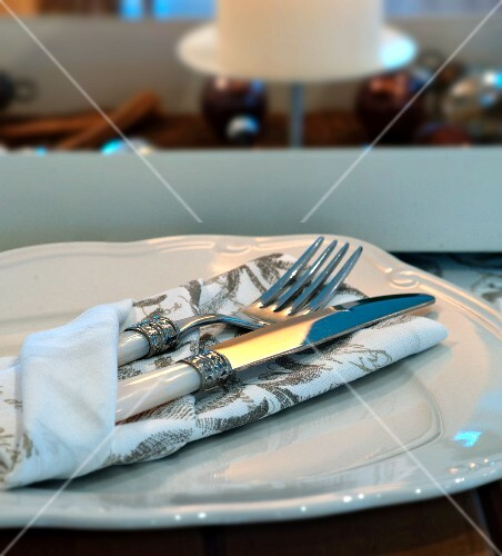 Cutlery and a napkin on a plate for Christmas dinner