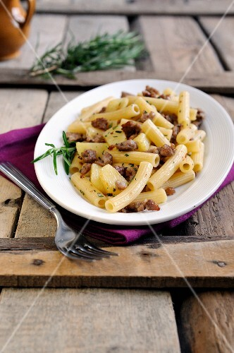 Penne pasta with Italian sausage, potato and rosemary